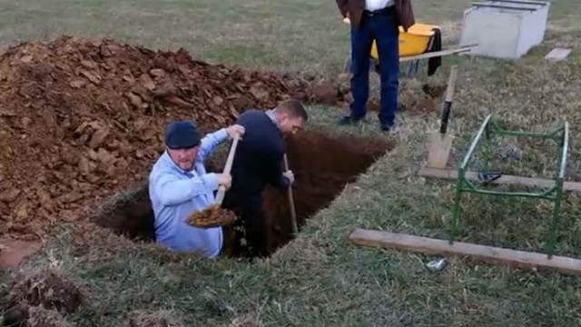 Family forced to dig woman's grave after cemetery leaves burial plot unfinished