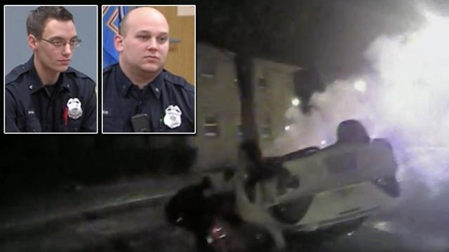 Hero cops pull teens from burning car that crashed right before their eyes
