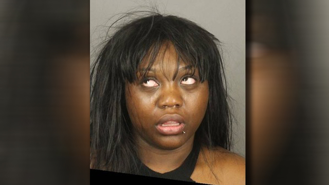 Police: Woman tries to hit ex with car, hits wrong person