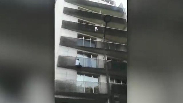 WATCH: 'Spiderman' hero saves child dangling from balcony