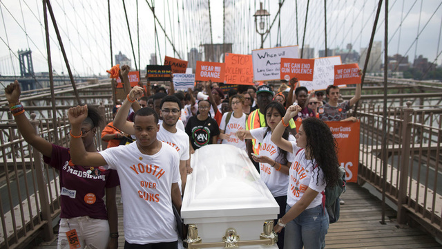 Thousands march across NYC's Brooklyn Bridge in gun protest