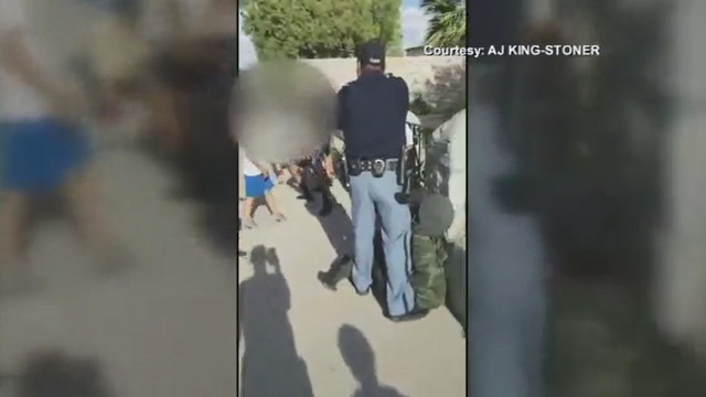 Mom says Texas officer choked boy before aiming gun at kids