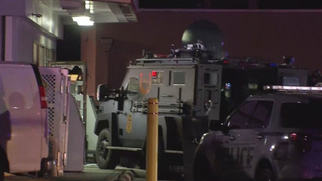 SWAT standoff ends peacefully after robbery, shots fired