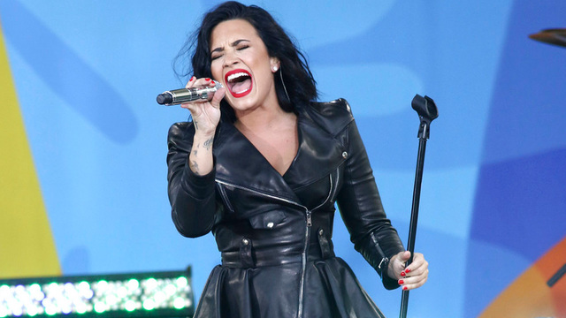 Pop star Demi Lovato awake and recovering with family, rep says